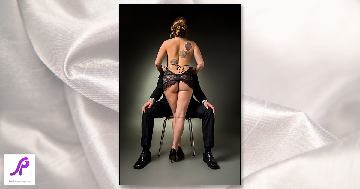 couples boudoir. woman stood in front of man seated