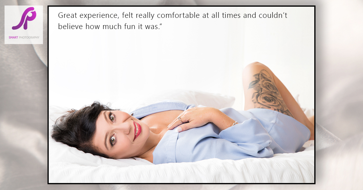 boudoir client testimonial lying on back on bed in mans shirt