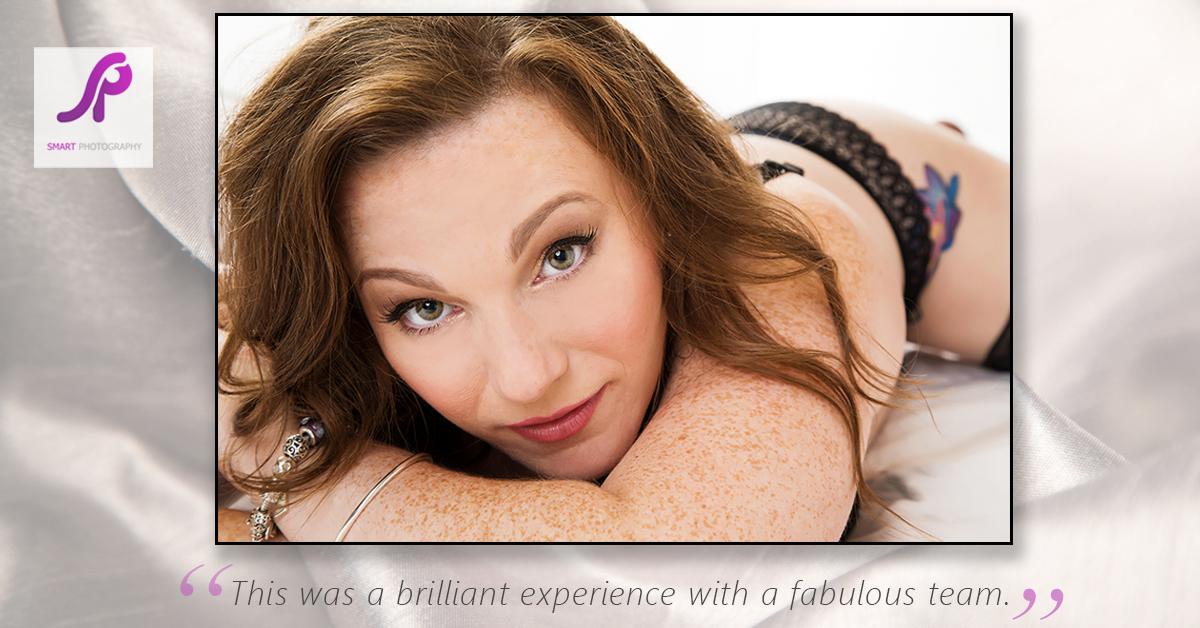 boudoir client testimonial with client lying on front on bed set
