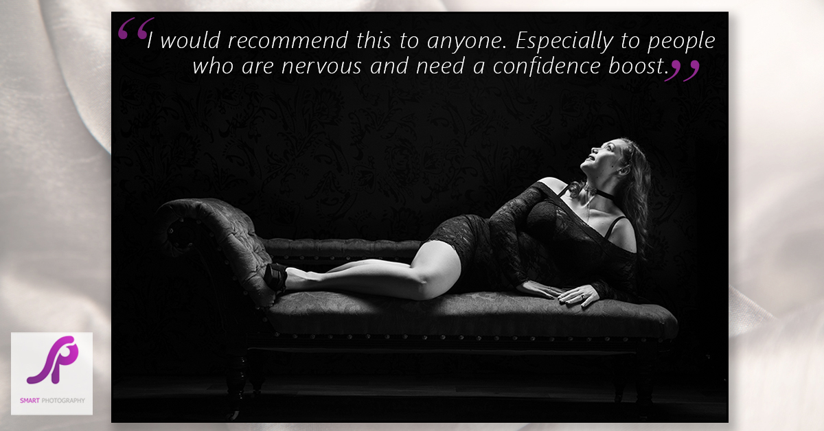 boudoir client testimonial reclining on chaise lounge in black and white