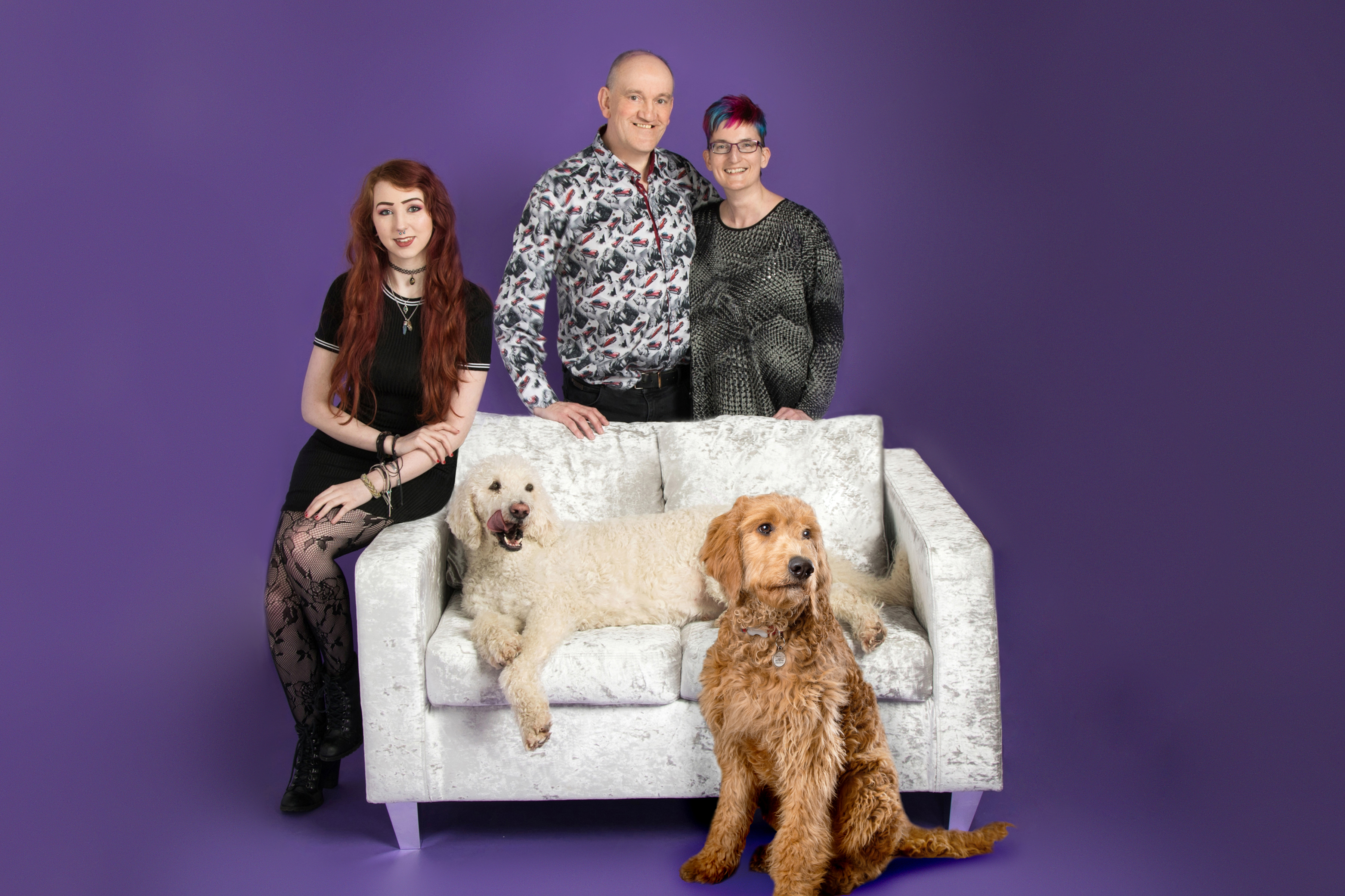 smart photography team photo around sofa including dogs