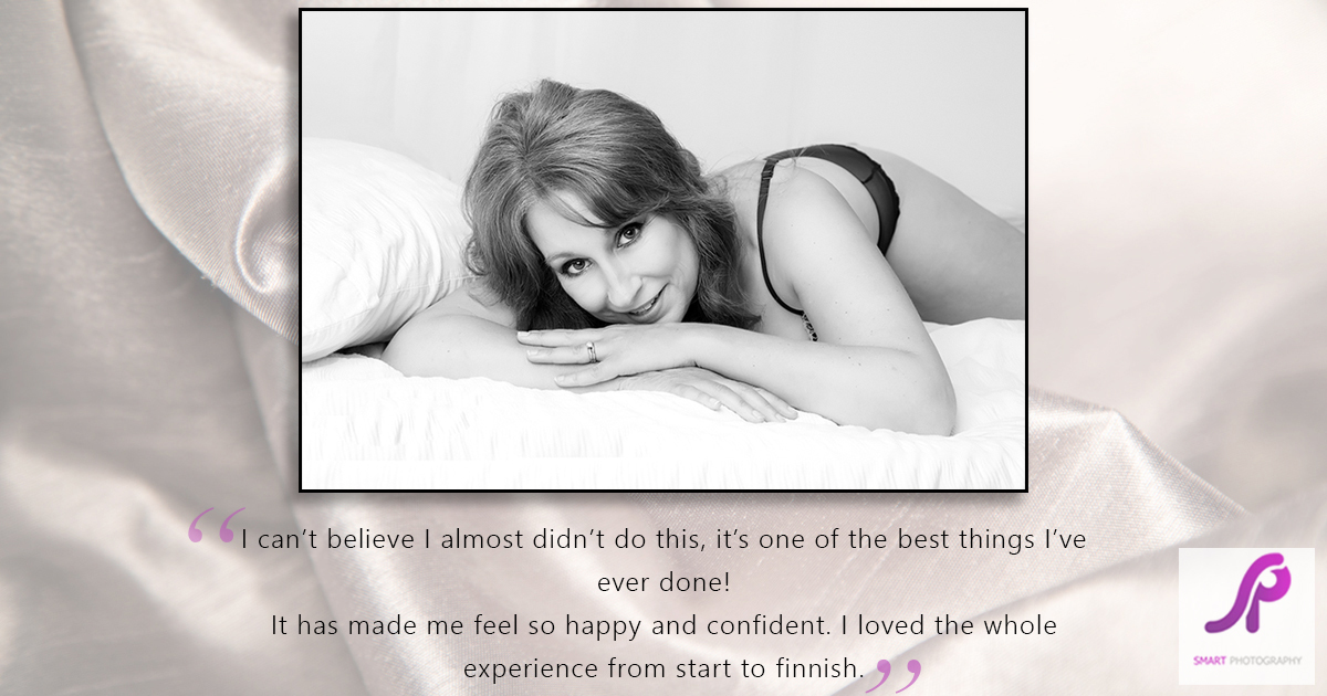 boudoir client testimonial with client lying on front on bed set in black and white