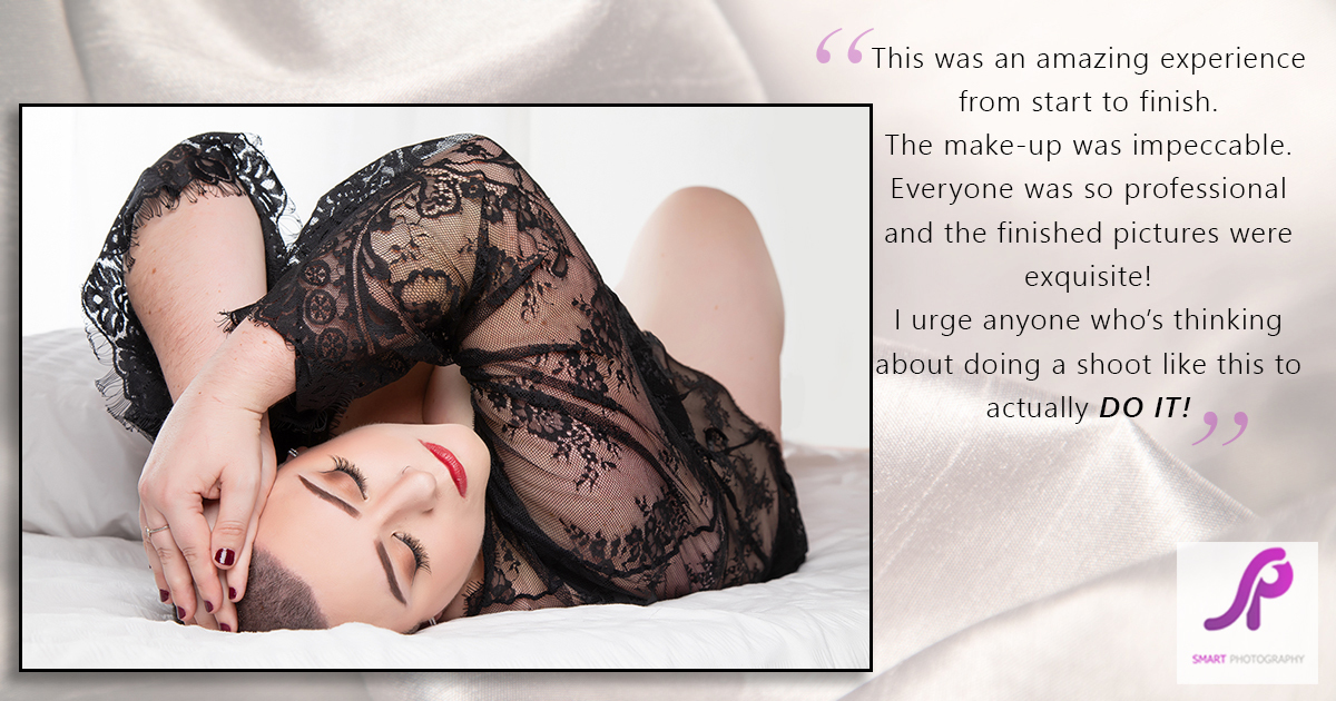 boudoir client testimonial lying on back on bed set wearing lace black robe