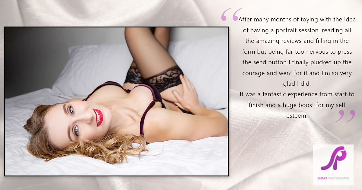 boudoir client testimonial lying on back on bed set with legs up wall